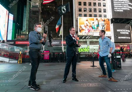 Daniel Boulud, John Houghtaling, Andrew Rigie seen when BIG created special advertisement in order to push for speedy opening of small businesses and darken some billboards for 1 minute on Times Square
