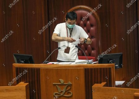An employee cleans the seat reserved for Council President Andrew Leung before resuming the second reading of the National Anthem Bill in the Legislative Council of Hong Kong, China, 28 May 2020. Under the controversial bill, anyone convicted of misusing or insulting the 'March of the Volunteers' (the national anthem of the People's Republic of China) could face a fine of up to 50,000 Hong Kong dollars (6,449 US dollars) and three years in jail. The bill is expected to be put to a vote on 04 June.