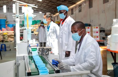 Stock Photo of Employees make masks at Lida Packaging Products Limited in Mukono district, central Uganda, May 26, 2020.   Ugandan President Yoweri Museveni on Tuesday launched two production lines at a Chinese-owned factory making face masks to plug shortages as the country eased lockdown restrictions.