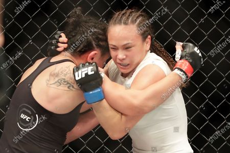 Carla Esparza, left, fights with Michelle Waterson during a UFC 249 mixed martial arts bout, in Jacksonville, Fla