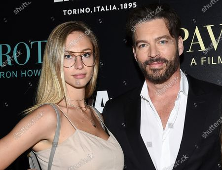 """Singer Harry Connick Jr. with his daughter Georgia at a special screening of """"Pavarotti"""" in New York. The Grammys is putting together an event featuring Brad Pitt, Oprah Winfrey, Herbie Hancock and Harry Connick, Jr. to honor essential workers across America. The Recording Academy, which puts on the Grammy Awards annually, announced Thursday that the two-hour special, """"UNITED WE SING: A GRAMMY SALUTE TO THE UNSUNG HEROES,"""" will air June 21 on CBS. It will follow host Connick Jr. and his filmmaker-daughter Georgia on road trip celebrating and thanking essential workers during the coronavirus pandemic"""