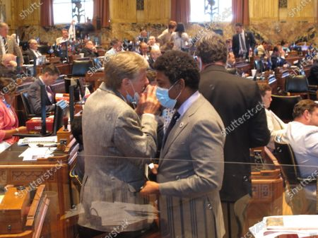 Stock Picture of Rep. Francis Thompson, D-Delhi, left, speaks with Rep. Gary Cater, D-New Orleans, on the House floor during a long day of bill debate,, in Baton Rouge, La