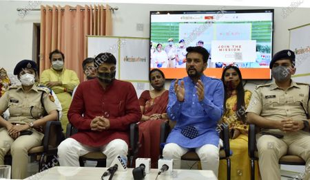 Stock Image of Union Minister of State for Finance Anurag Thakur (2R) along with Delhi BJP President Manoj Tiwari (2L), ACP Pragya Anand (L) and ACP Deepak Yadav (R) during the launch of 'Mission Anivarya', in collaboration with Delhi Police, on World Menstrual Hygiene Day, at Mother Teresa Crescent Marg on May 28, 2020 in New Delhi,  India.  The party plans to distribute six lakh sanitary pads among the women in the city's slums.