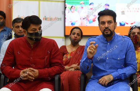 Union Minister of State for Finance Anurag Thakur (R) along with Delhi BJP President Manoj Tiwari (L) during the launch of 'Mission Anivarya', in collaboration with Delhi Police, on World Menstrual Hygiene Day, at Mother Teresa Crescent Marg on May 28, 2020 in New Delhi,  India.  The party plans to distribute six lakh sanitary pads among the women in the city's slums.