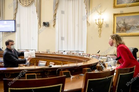 """United States Secretary of Veterans Affairs (VA) Robert Wilkie, left, holds up a US Department of Veterans Affairs document titled """"Hydroxychloroquine Timeline and Utilization"""" as he speaks with Chairwoman United States Representative Debbie Wasserman Schultz (Democrat of Florida), right, before a US House Appropriations Subcommittee on Military Construction, Veterans Affairs, and Related Agencies hearing on Capitol Hill in Washington,, on the Department of Veterans Affairs Response to COVID-19."""