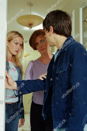 Stock Image of Ep 3221 Monday 15th July 2002 Andy sets off for Macclesfield to find Katie, who is staying with her mother. His hopes of reconciliation are promptly dashed, as Caroline refuses to let him see her daughter, insisting that Katie never wants to see him again. Andy insists he won't give up as Katie appears at the doorway. With Katie Addyman, as played by Sammy Winward ; Andy Sugden, as played by Kelvin Fletcher ; Caroline Kershaw, as played by Daryl Fishwick.