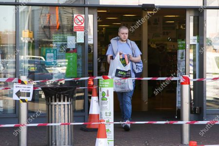 A shopper leaves Asda Living store in Tottenham Hale, north London with a shopping bag. Prime Minister Boris Johnson has said that from 15 June all non-essential retailers, including shops selling clothes and indoor markets can open as lockdown restrictions are eased in England after ten weeks of the coronavirus lockdown.