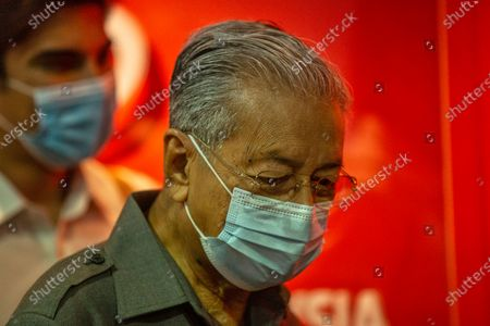 Stock Photo of Malaysian former prime minister Mahathir Mohamad wearing a face mask (R) and former Youth and Sports Minister, Syed Saddiq Syed Abdul Rahman leave after a media conference at Parti Pribumi Bersatu Malaysia (PPBM) headquarters in Kuala Lumpur, Malaysia, 29 May 2020. Media reports state on 28 May 2020 that Malaysian former prime minister Mahathir Mohamad, 94, has been sacked along with four other co-founders and parliamentarians from the Parti Pribumi Bersatu Malaysia (PPBM). Mahathir, who led the party to victory in the 2018 general election, has disputed his sacking, media added.