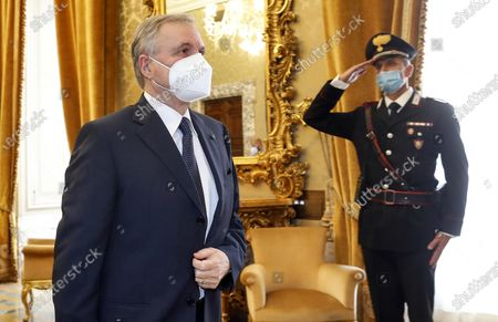 Ignazio Visco (L), the governor of the Central Bank of Italy, wears a face mask as he arrives for the presentation of the bank's annual report in Rome, Italy, 29 May 2020.