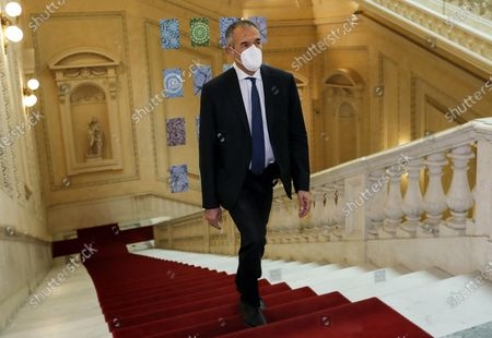 Economist Carlo Cottarelli wears a face mask as he arrives for the presentation of the Central Bank of Italy's annual report in Rome, Italy, 29 May 2020.