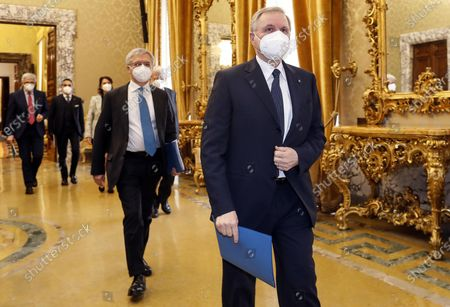 Ignazio Visco (front), the governor of the Central Bank of Italy, wears a face mask as he arrives for the presentation of the bank's annual report in Rome, Italy, 29 May 2020.