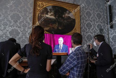 Reporters gather in front of a screen to watch Ignazio Visco, the governor of the Central Bank of Italy, present the bank's annual report in Rome, Italy, 29 May 2020.