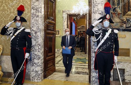 Ignazio Visco (C), the governor of the Central Bank of Italy, wears a face mask as he arrives for the presentation of the bank's annual report in Rome, Italy, 29 May 2020.