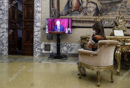 A reporter sits in front of a screen to watch Ignazio Visco, the governor of the Central Bank of Italy, present the bank's annual report in Rome, Italy, 29 May 2020.