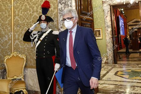 Ignazio Visco (R), the governor of the Central Bank of Italy, wears a face mask as he arrives for the presentation of the bank's annual report in Rome, Italy, 29 May 2020.