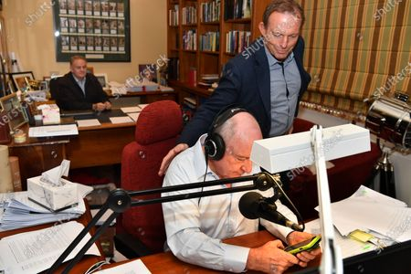 NSW One Nation Member of Parliament (MP) Mark Latham (back) and former prime minister Tony Abbott (R) join Australian radio broadcaster Alan Jones during his final breakfast show for 2GB from his home at Fitzroy Falls in the Southern Highlands, New South Wales, Australia, 29 May 2020. Broadcaster Alan Jones will retire from his radio program on 29 May.
