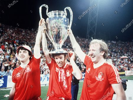 Nottingham Forest's John Robertson, left, Ian Bowyer, center, and Kenny Burns, right, carry the European Cup in triumph after their 1-0 win against Malmo FF in Munich, Germany. N is for Nottingham Forest. Of all England's 13 wins Forest's consecutive triumphs in the 1979 and 1980 were the most unlikely. Only two-years before their win in Munich, Forest were playing in England's second tier, but their meteoric rise under the leadership of maverick boss Brian Clough is the stuff legends are made of