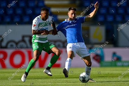 Fuerth's Julian Green (L) in action against Darmstadt's Fabian Schnellhardt during the German Bundesliga Second Division soccer match between SV Darmstadt 98 and SpVgg Greuther Fuerth at Merck-Stadion in Darmstadt, Germany, 29 May 2020.