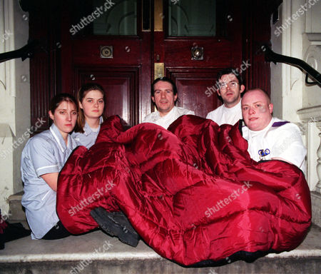 Stock Image of Nurses Protest On The Steps Of Health Minister Frank Dobson's Home In Central London. From Left To Right; Katie Playle (19) Becky Regan (20) John Quinn (36) Noel Moone (28) And Jon Dempsey (23).the Student Nurses Fear They Will Be Made Homeless By Nhs Privatisation And Due To A Hospital Merger It Means That Staff Residences Will Be Cut And That Staff Jobs Will Be Privatised.