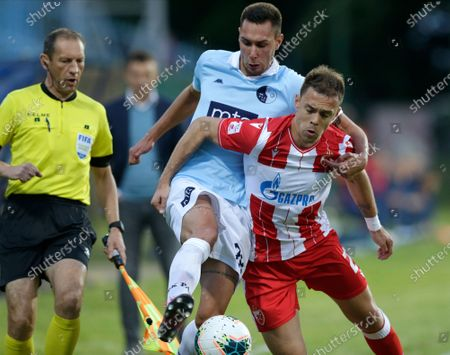 Rad's Veljko Trifunovic (L) in action against Red Star's Milan Rodic (R) during the Serbian SuperLiga soccer match between Rad and Red Star in Belgrade, Serbia, 29 May 2020. The Serbian SuperLiga resumes without spectators after a suspension because of the coronavirus pandemic.