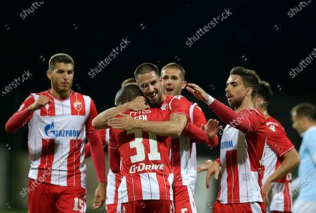 Red Star's Milos Degenek (C) celebrates with teammates  after scoring a goal during the Serbian SuperLiga soccer match between Rad and Red Star in Belgrade, Serbia, 29 May 2020. The Serbian SuperLiga resumes without spectators after a suspension because of the coronavirus pandemic.