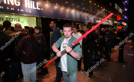 Editorial picture of Star Wars Tickets Go On Sale At The Odeon Leicester Square. Owen Davies An Ardent Fan Of The Star Wars Films Holds A Darth Maul Light Saber As He Queues.