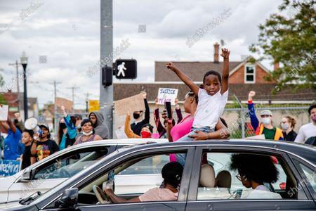 Protestors take over an intersection on May 29, 2020 in Columbus, Ohio in solidarity with Minneapolis following the killing of George Floyd and for Christopher Radden, who was arrested by the Columbus Police Department during protests on Wednesday night.