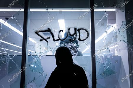 People vandalize a Walgreens in downtown Oakland during protests against the Minneapolis police shooting of George Floyd in Oakland, Calif. Floyd died in police custody Monday in Minneapolis