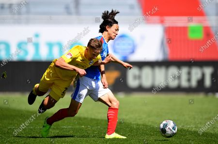 Stock Photo of Lee Jae-Sung (R) of Kiel in action against Cedric Brunner (L) of Bielefeld during the German Bundesliga second division soccer match between Holstein Kiel and Arminia Bielefeld at Holstein-Stadion in Kiel, Germany, 30 May 2020.