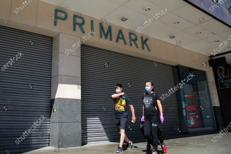 Members of the public wearing face coverings walk past Primark store in Wood Green, north London. Prime Minister Boris Johnson has said that from 15 June all non-essential retailers, including shops selling clothes and indoor markets can open as lockdown restrictions are eased in England after ten weeks of the coronavirus lockdown.