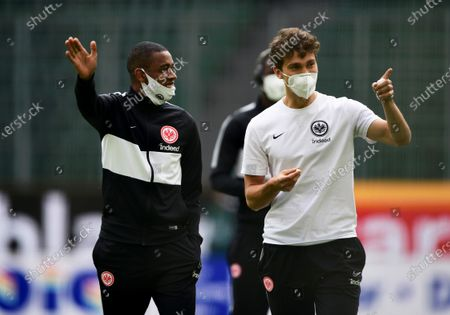 Eintracht Frankfurt players Gelson Fernandes (L) and Lucas Torro (R) wear protective face masks prior to the German Bundesliga soccer match between VfL Wolfsburg and Eintracht Frankfurt in Wolfsburg, Germany, 30 May 2020.