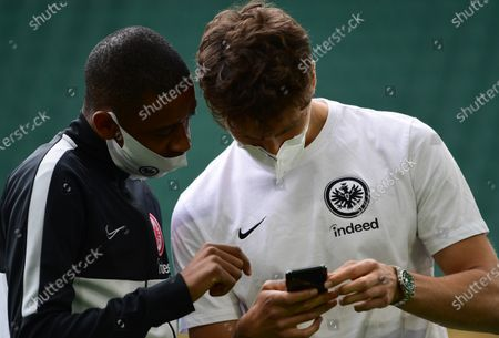 Stock Picture of Eintracht Frankfurt players Gelson Fernandes (L) and Lucas Torro (R) wear protective face masks prior to the German Bundesliga soccer match between VfL Wolfsburg and Eintracht Frankfurt in Wolfsburg, Germany, 30 May 2020.