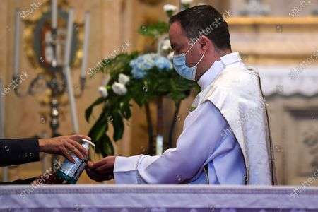 Priest Joao Paulo Coelho Alves, Rector of the Basilica of Bom Jesus do Monte in Braga, celebrates the first mass after a stop of more than two months because of the covid-19 pandemic, Braga, Portugal, 30 May 2020. New rules for the faithful and adaptations of the cults have been adopted by the Catholic Church in order to reopen the churches.