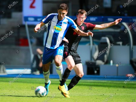 Augsburg's Stephan Lichtsteiner (R) in action against Hertha's Marko Grujic (L) during the German Bundesliga soccer match between Hertha BSC and FC Augsburg in Berlin, Germany, 30 May 2020.