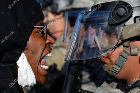 Protesters and National Guardsmen face off on East Lake Street, in St. Paul, Minn. Protests continued following the death of George Floyd, who died after being restrained by Minneapolis police officers on Memorial Day