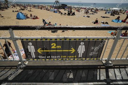 "Stock Picture of Photo taken on May 30, 2020 shows a sign encouraging social distancing at Bournemouth Beach in Bournemouth, Britain. British Prime Minister Boris Johnson on Thursday unveiled some ""limited"" and ""cautious"" easing of the country's coronavirus lockdown measures."