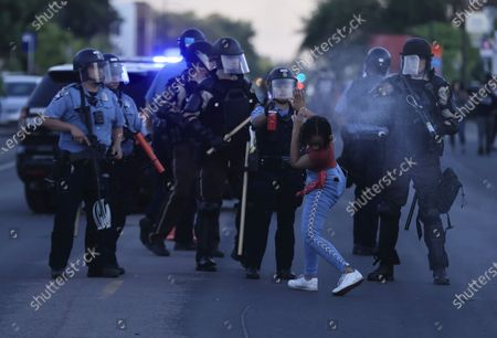 A protester is sprayed with pepper spray by a Minneapolis Police officer as protesters demonstrate during the fifth day of protests over the arrest of George Floyd, who later died in police custody, in Minneapolis, Minnesota, USA, 30 May 2020. A bystander's video posted online on 25 May, appeared to show George Floyd, 46, pleading with arresting officers that he couldn't breathe as an officer knelt on his neck. The unarmed black man later died in police custody.