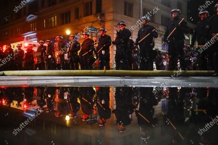 Police are reflected as they stand guard, in Philadelphia, during a protest over the death of George Floyd. Protests were held throughout the country over the death of Floyd, a black man who died after being restrained by Minneapolis police officers on May 25
