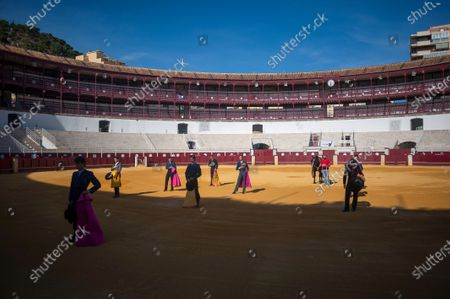Spanish bullfighter Fernando Rey and students of Malaga bullfighting school are seen during a masterclass of bullfighting at an empty La Malagueta bullring as partial lockdown continues in the country amid coronavirus disease.Spanish bullfighter Fernando Rey has given a masterclass with students of the bullfighting school without the presence of spectators as a measure to prevent the spread of coronavirus. This situation shows an empty bullring and being the first bullfighting event in the city since they started the emergency state.
