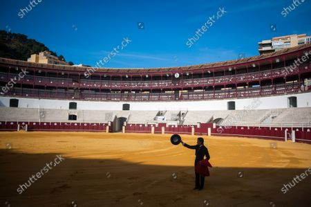 Peruvian student of Malaga bullfighting school Julio Alguiar seen  during a masterclass of bullfighting at an empty La Malagueta bullring as partial lockdown continues in the country amid coronavirus disease.Spanish bullfighter Fernando Rey has given a masterclass with students of the bullfighting school without the presence of spectators as a measure to prevent the spread of coronavirus. This situation shows an empty bullring and being the first bullfighting event in the city since they started the emergency state.