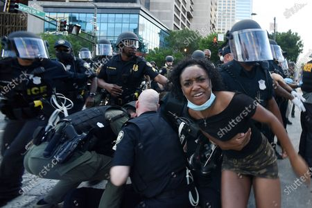 Atlanta Police detain demonstrators protesting, in Atlanta. The protest started peacefully earlier in the day before demonstrators clashed with police