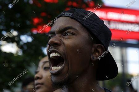 Demonstrators protest, in Atlanta