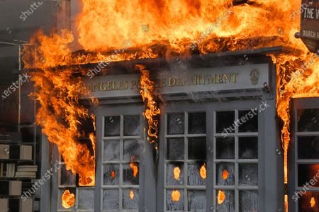 Los Angeles Police Department kiosk is seen ablaze in The Grove shopping center during a protest over the death of George Floyd, in Los Angeles. Protests were held in U.S. cities over the death of Floyd, a black man who died after being restrained by Minneapolis police officers on May 25