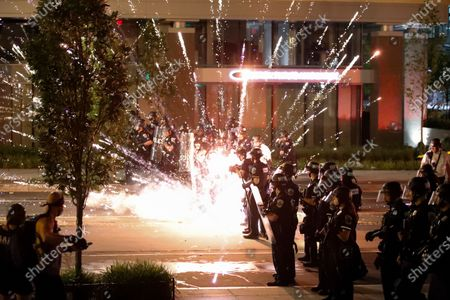 Firework explodes by a police line as demonstrators gather to protest the death of George Floyd, near the White House in Washington. Floyd died after being restrained by Minneapolis police officers