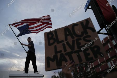 Protesters rally, in Las Vegas, over the death of George Floyd, a black man who was in police custody in Minneapolis. Floyd died after being restrained by Minneapolis police officers on Memorial Day