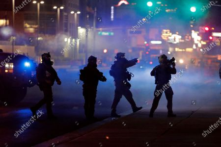 Police walk through tear gas as they try to disperse protesters, in Las Vegas, over the death of George Floyd, a black man who was in police custody in Minneapolis. Floyd died after being restrained by Minneapolis police officers on Memorial Day