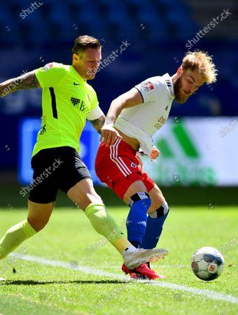 Timo Letschert (R) of Hamburg challenges Manuel Schaeffler of Wehen Wiesbaden during the German Bundesliga second division soccer match between Hamburger SV and SV Wehen Wiesbaden in Hamburg, Germany, 31 May 2020.