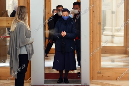 A catholic nun walks through a sanitizing tunnel to attend the Sunday Mass at the Mother Teresa cathedral amid the ongoing coronavirus COVID-19 pandemic in Pristina, Kosovo, 31 May 2020. Faithful attended the Sunday mass for the first time since mid-March when the Kosovo's government closed borders and suspended activities in a bid to control the spread of the COVID-19 disease caused by the SARS-CoV-2 coronavirus in the West Balkan country.