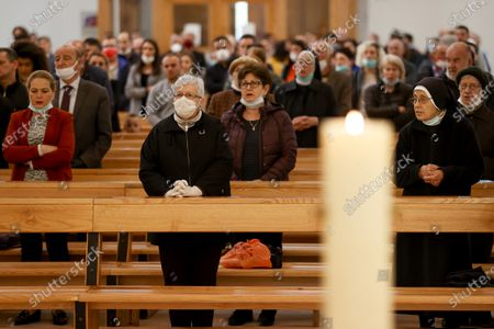 Faithful attend the Sunday Mass at the Mother Teresa cathedral amid the ongoing coronavirus COVID-19 pandemic in Pristina, Kosovo, 31 May 2020. Faithful attended the Sunday mass for the first time since mid-March when the Kosovo's government closed borders and suspended activities in a bid to control the spread of the COVID-19 disease caused by the SARS-CoV-2 coronavirus in the West Balkan country.