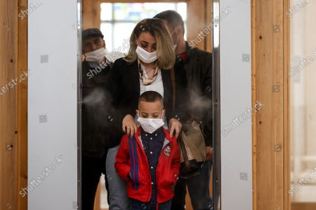 Faithful wearing face masks walks through a sanitizing tunnel to attend the Sunday Mass at the Mother Teresa cathedral amid the ongoing coronavirus COVID-19 pandemic in Pristina, Kosovo, 31 May 2020. Faithful attended the Sunday mass for the first time since mid-March when the Kosovo's government closed borders and suspended activities in a bid to control the spread of the COVID-19 disease caused by the SARS-CoV-2 coronavirus in the West Balkan country.